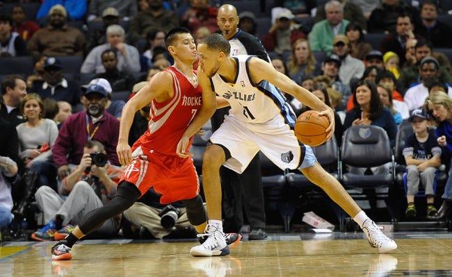 Nov 25, 2013; Memphis, TN, USA; Houston Rockets point guard Jeremy Lin (7) guards Memphis Grizzlies small forward Tayshaun Prince (21) during the third quarter at FedExForum. Mandatory Credit: Justin Ford-USA TODAY Sports
