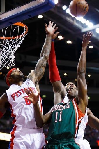 Nov 25, 2013; Auburn Hills, MI, USA; Milwaukee Bucks point guard Brandon Knight (11) shoots on Detroit Pistons small forward Josh Smith (6) in the second quarter at The Palace of Auburn Hills. Mandatory Credit: Rick Osentoski-USA TODAY Sports