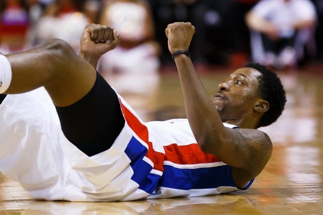Nov 25, 2013; Auburn Hills, MI, USA; Detroit Pistons shooting guard Kentavious Caldwell-Pope (5) reacts after making a three point basket and getting fouled in the second half against the Milwaukee Bucks at The Palace of Auburn Hills. Mandatory Credit: Rick Osentoski-USA TODAY Sports