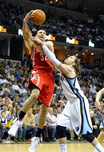 Nov 25, 2013; Memphis, TN, USA; Houston Rockets shooting guard Francisco Garcia (32) is fouled by Memphis Grizzlies small forward Mike Miller (13) during the fourth quarter at FedExForum. Mandatory Credit: Justin Ford-USA TODAY Sports