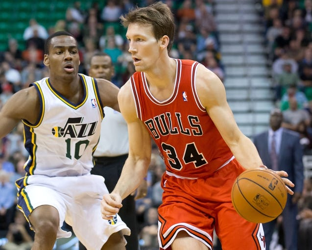 Nov 25, 2013; Salt Lake City, UT, USA; Chicago Bulls guard Mike Dunleavy (34) dribbles around Utah Jazz point guard Alec Burks (10) during the first half at EnergySolutions Arena. Mandatory Credit: Russ Isabella-USA TODAY Sports