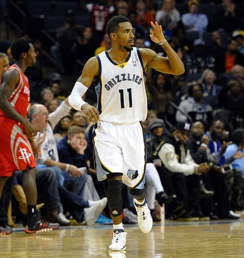 Nov 25, 2013; Memphis, TN, USA; Memphis Grizzlies point guard Mike Conley (11) reacts after scoring against the Houston Rockets during the fourth quarter at FedExForum. Houston Rockets beat the Memphis Grizzlies 93-86. Mandatory Credit: Justin Ford-USA TODAY Sports