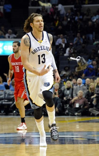 Nov 25, 2013; Memphis, TN, USA; Memphis Grizzlies small forward Mike Miller (13) tosses his shoe during the game against the Houston Rockets during the fourth quarter at FedExForum. Houston Rockets beat the Memphis Grizzlies 93-86. Mandatory Credit: Justin Ford-USA TODAY Sports