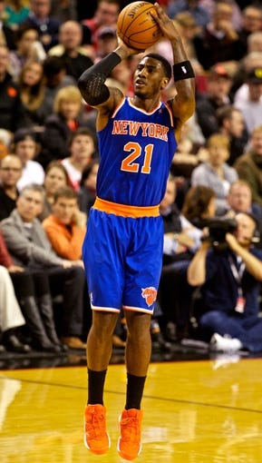 Nov 25, 2013; Portland, OR, USA; New York Knicks shooting guard Iman Shumpert (21) shoots against the Portland Trail Blazers at the Moda Center. Mandatory Credit: Craig Mitchelldyer-USA TODAY Sports