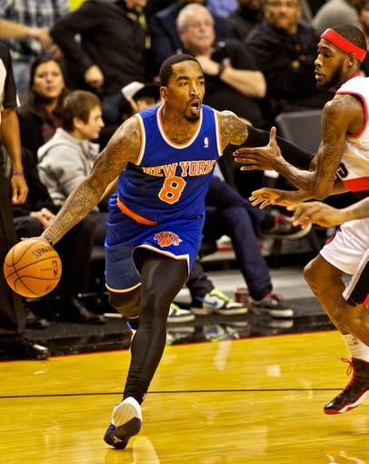 Nov 25, 2013; Portland, OR, USA; New York Knicks shooting guard J.R. Smith (8) drives past Portland Trail Blazers shooting guard Will Barton (5) at the Moda Center. Mandatory Credit: Craig Mitchelldyer-USA TODAY Sports
