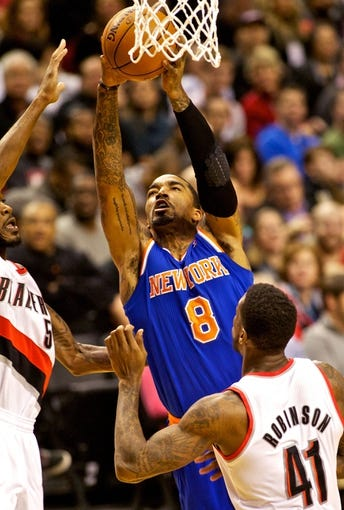 Nov 25, 2013; Portland, OR, USA; New York Knicks shooting guard J.R. Smith (8) shoots over Portland Trail Blazers power forward Thomas Robinson (41) at the Moda Center. Mandatory Credit: Craig Mitchelldyer-USA TODAY Sports