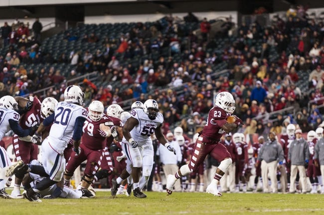 Nov 23, 2013; Philadelphia, PA, USA; Temple Owls running back Zaire Williams (23) carries for a touchdown during the second quarter against the Connecticut Huskies at Lincoln Financial Field. UCONN defeated Temple 28-21. Mandatory Credit: Howard Smith-USA TODAY Sports