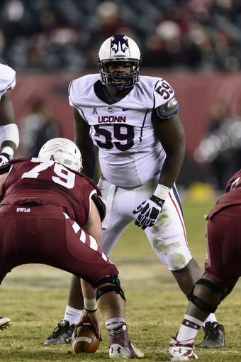Nov 23, 2013; Philadelphia, PA, USA; Connecticut Huskies defensive tackle Shamar Stephen (59) during the second quarter against the Temple Owls at Lincoln Financial Field. UCONN defeated Temple 28-21. Mandatory Credit: Howard Smith-USA TODAY Sports