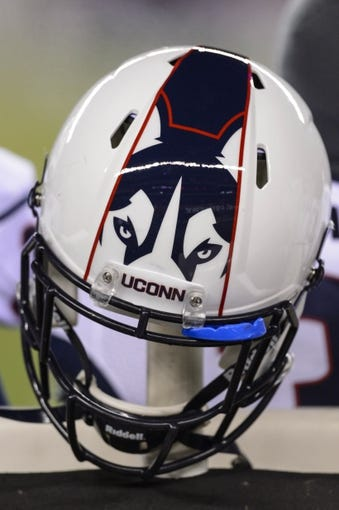 Nov 23, 2013; Philadelphia, PA, USA; A Connecticut Huskies helmet on the bench during the third quarter against the Temple Owls at Lincoln Financial Field. UCONN defeated Temple 28-21. Mandatory Credit: Howard Smith-USA TODAY Sports