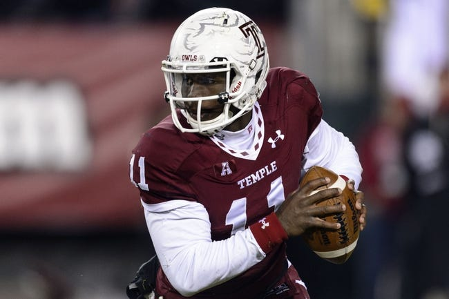 Nov 23, 2013; Philadelphia, PA, USA; Temple Owls quarterback P.J. Walker (11) looks to pass during the third quarter against the Connecticut Huskies at Lincoln Financial Field. UCONN defeated Temple 28-21. Mandatory Credit: Howard Smith-USA TODAY Sports