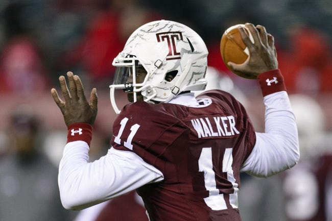 Nov 23, 2013; Philadelphia, PA, USA; Temple Owls quarterback P.J. Walker (11) passes the ball during the third quarter against the Connecticut Huskies at Lincoln Financial Field. UCONN defeated Temple 28-21. Mandatory Credit: Howard Smith-USA TODAY Sports