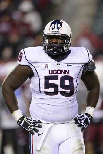 Nov 23, 2013; Philadelphia, PA, USA; Connecticut Huskies defensive tackle Shamar Stephen (59) during the third quarter against the Temple Owls at Lincoln Financial Field. UCONN defeated Temple 28-21. Mandatory Credit: Howard Smith-USA TODAY Sports