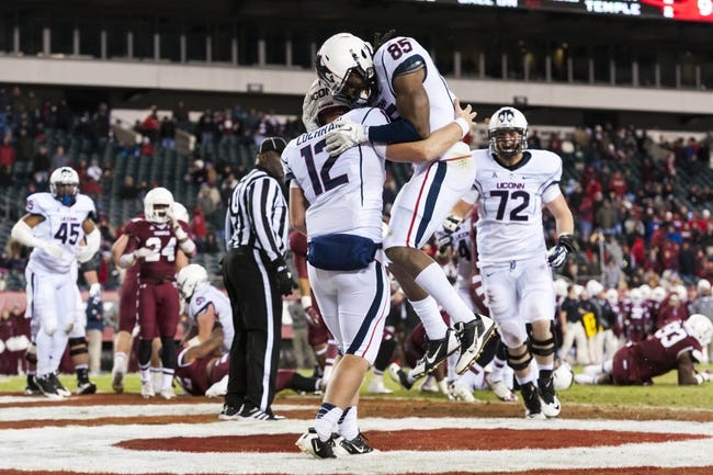 Nov 23, 2013; Philadelphia, PA, USA; Connecticut Huskies quarterback Casey Cochran (12) celebrates scoring with wide receiver Geremy Davis (85) during the fourth quarter against the Temple Owls at Lincoln Financial Field. UCONN defeated Temple 28-21. Mandatory Credit: Howard Smith-USA TODAY Sports