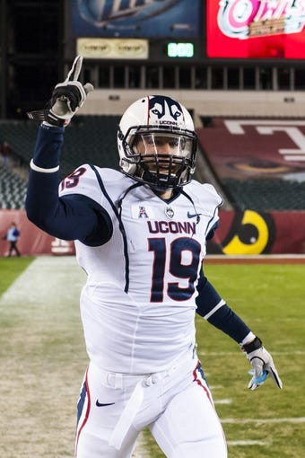 Nov 23, 2013; Philadelphia, PA, USA; Connecticut Huskies cornerback Ellis Marder (19) celebrates after defeating the Temple Owls at Lincoln Financial Field. UCONN defeated Temple 28-21. Mandatory Credit: Howard Smith-USA TODAY Sports