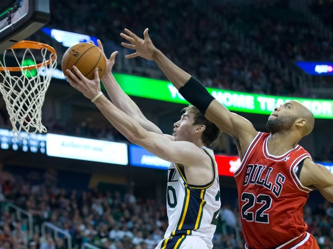 Nov 25, 2013; Salt Lake City, UT, USA; Utah Jazz shooting guard Gordon Hayward (20) goes to the basket in front of Chicago Bulls power forward Taj Gibson (22) during the second half at EnergySolutions Arena. The Jazz won 89-83 in overtime. Mandatory Credit: Russ Isabella-USA TODAY Sports