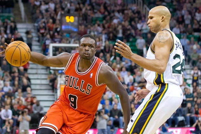 Nov 25, 2013; Salt Lake City, UT, USA; Chicago Bulls small forward Luol Deng (9) drives while defended by Utah Jazz small forward Richard Jefferson (24) during the second half at EnergySolutions Arena. The Jazz won 89-83 in overtime. Mandatory Credit: Russ Isabella-USA TODAY Sports