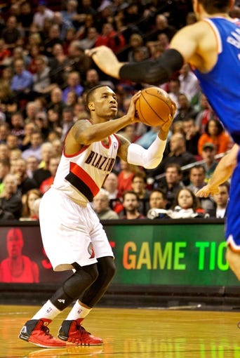 Nov 25, 2013; Portland, OR, USA; Portland Trail Blazers point guard Damian Lillard (0) shoots against the New York Knicks at the Moda Center. Mandatory Credit: Craig Mitchelldyer-USA TODAY Sports