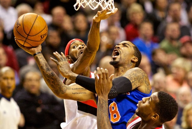 Nov 25, 2013; Portland, OR, USA; New York Knicks shooting guard J.R. Smith (8) shots over Portland Trail Blazers shooting guard Will Barton (5) at the Moda Center. Mandatory Credit: Craig Mitchelldyer-USA TODAY Sports