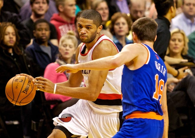 Nov 25, 2013; Portland, OR, USA; Portland Trail Blazers small forward Nicolas Batum (88) drives to the basket against the New York Knicks at the Moda Center. Mandatory Credit: Craig Mitchelldyer-USA TODAY Sports