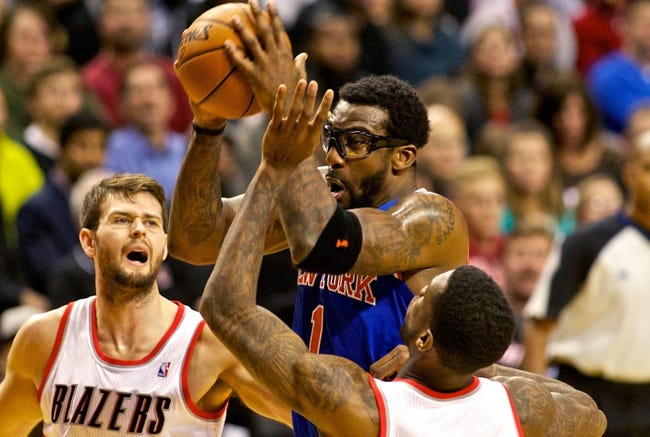Nov 25, 2013; Portland, OR, USA; New York Knicks power forward Amar'e Stoudemire (1) shoots over Portland Trail Blazers center Joel Freeland (19) at the Moda Center. Mandatory Credit: Craig Mitchelldyer-USA TODAY Sports