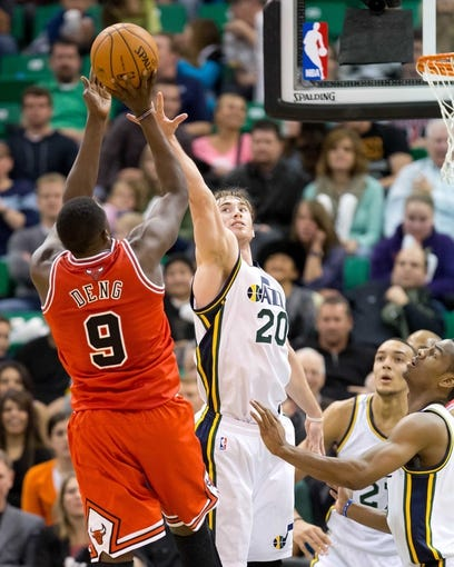 Nov 25, 2013; Salt Lake City, UT, USA; Chicago Bulls small forward Luol Deng (9) shoots while defended by Utah Jazz shooting guard Gordon Hayward (20) during the second half at EnergySolutions Arena. The Jazz won 89-83 in overtime. Mandatory Credit: Russ Isabella-USA TODAY Sports