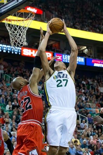 Nov 25, 2013; Salt Lake City, UT, USA; Utah Jazz center Rudy Gobert (27) shoots over Chicago Bulls power forward Taj Gibson (22) during the second half at EnergySolutions Arena. The Jazz won 89-83 in overtime. Mandatory Credit: Russ Isabella-USA TODAY Sports