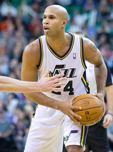 Nov 25, 2013; Salt Lake City, UT, USA; Utah Jazz small forward Richard Jefferson (24) controls the ball during the second half against the Chicago Bulls at EnergySolutions Arena. The Jazz won 89-83 in overtime. Mandatory Credit: Russ Isabella-USA TODAY Sports