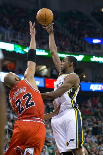 Nov 25, 2013; Salt Lake City, UT, USA; Utah Jazz small forward Jeremy Evans (40) shoots over Chicago Bulls power forward Taj Gibson (22) during the second half at EnergySolutions Arena. The Jazz won 89-83 in overtime. Mandatory Credit: Russ Isabella-USA TODAY Sports