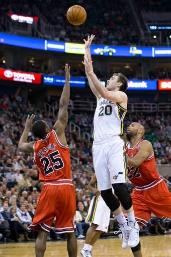 Nov 25, 2013; Salt Lake City, UT, USA; Utah Jazz shooting guard Gordon Hayward (20) shoots over Chicago Bulls point guard Marquis Teague (25) during the second half at EnergySolutions Arena. The Jazz won 89-83 in overtime. Mandatory Credit: Russ Isabella-USA TODAY Sports