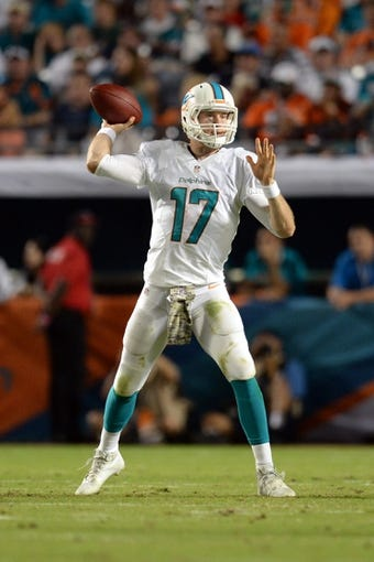 Nov 17, 2013; Miami Gardens, FL, USA; Miami Dolphins quarterback Ryan Tannehill (17) throws a pass against the San Diego Chargers at Sun Life Stadium. The Dolphins won the game 20-16. Mandatory Credit: Joe Camporeale-USA TODAY Sports