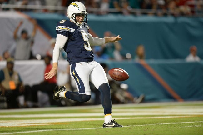 Nov 17, 2013; Miami Gardens, FL, USA; San Diego Chargers punter Mike Scifres (5) punts the ball against the Miami Dolphins at Sun Life Stadium. The Dolphins won the game 20-16. Mandatory Credit: Joe Camporeale-USA TODAY Sports