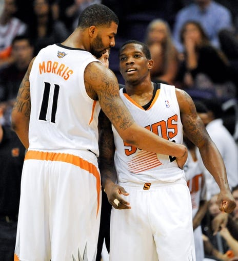 Nov 8, 2013; Phoenix, AZ, USA; Phoenix Suns power forward Markieff Morris (11) and point guard Eric Bledsoe (2) talk strategy during the fourth quarter against the Denver Nuggets at US Airways Center. Mandatory Credit: Casey Sapio-USA TODAY Sports