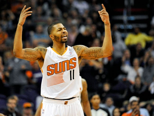 Nov 8, 2013; Phoenix, AZ, USA; Phoenix Suns power forward Markieff Morris (11) celebrates during the third quarter against the Denver Nuggets at US Airways Center. Mandatory Credit: Casey Sapio-USA TODAY Sports