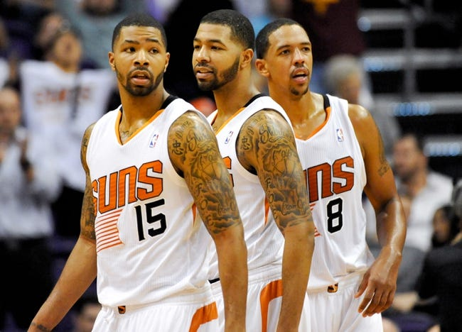 Nov 8, 2013; Phoenix, AZ, USA; Phoenix Suns power forward Marcus Morris (15) power forward Markieff Morris (11) and power forward Channing Frye (8) on the court during the fourth quarter against the Denver Nuggets at US Airways Center. Mandatory Credit: Casey Sapio-USA TODAY Sports