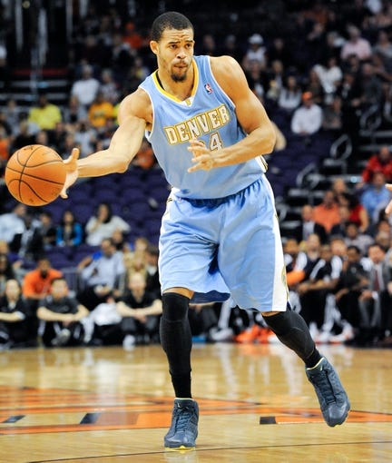 Nov 8, 2013; Phoenix, AZ, USA; Denver Nuggets center JaVale McGee (34) dribbles the ball during the first quarter against the Phoenix Suns at US Airways Center. Mandatory Credit: Casey Sapio-USA TODAY Sports