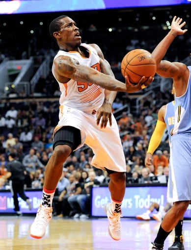 Nov 8, 2013; Phoenix, AZ, USA; Phoenix Suns point guard Eric Bledsoe (2) shoots the ball during the third quarter against the Denver Nuggets at US Airways Center. Mandatory Credit: Casey Sapio-USA TODAY Sports
