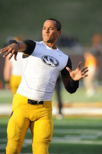 Nov 2, 2013; Columbia, MO, USA; Missouri Tigers quarterback James Franklin (1) warms up before the game against the Tennessee Volunteers at Faurot Field. Missouri won 31-3. Mandatory Credit: Denny Medley-USA TODAY Sports