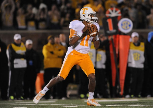 Nov 2, 2013; Columbia, MO, USA; Tennessee Volunteers quarterback Joshua Dobbs (11) throws a pass during the first half of the game against the Missouri Tigers at Faurot Field. Missouri won 31-3. Mandatory Credit: Denny Medley-USA TODAY Sports