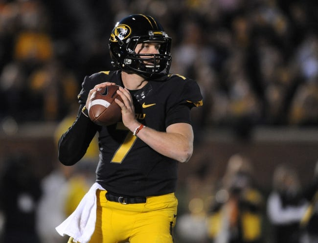 Nov 2, 2013; Columbia, MO, USA; Missouri Tigers quarterback Maty Mauk (7) throws a pass during the first half of the game against the Tennessee Volunteers at Faurot Field. Missouri won 31-3. Mandatory Credit: Denny Medley-USA TODAY Sports