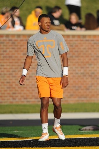 Nov 2, 2013; Columbia, MO, USA; Tennessee Volunteers quarterback Joshua Dobbs (11) warms up before the game against the Missouri Tigers at Faurot Field. Missouri won 31-3. Mandatory Credit: Denny Medley-USA TODAY Sports