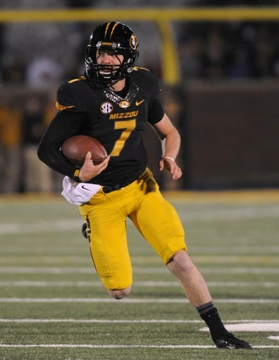 Nov 2, 2013; Columbia, MO, USA; Missouri Tigers quarterback Maty Mauk (7) runs the ball during the first half of the game against the Tennessee Volunteers at Faurot Field. Missouri won 31-3. Mandatory Credit: Denny Medley-USA TODAY Sports