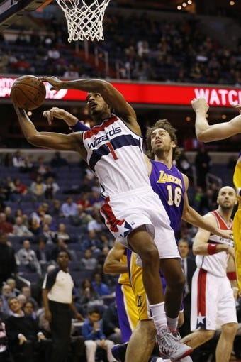 Nov 26, 2013; Washington, DC, USA; Washington Wizards small forward Trevor Ariza (1) shoots the ball in front of Los Angeles Lakers center Pau Gasol (16) in the first quarter at Verizon Center. Mandatory Credit: Geoff Burke-USA TODAY Sports