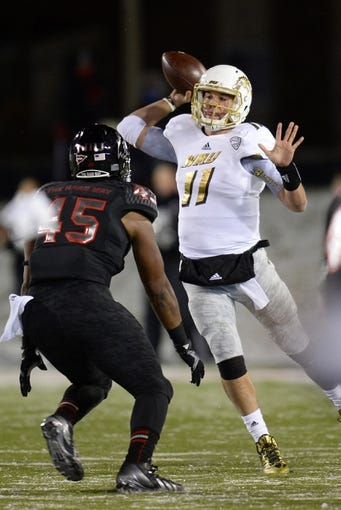 Nov 26, 2013; DeKalb, IL, USA; Western Michigan Broncos quarterback Zach Terrell (11) drops back to pass against the Northern Illinois Huskies during the first quarter at Huskie Stadium. Mandatory Credit: Mike DiNovo-USA TODAY Sports