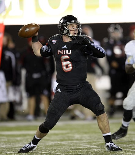 Nov 26, 2013; DeKalb, IL, USA; Northern Illinois Huskies quarterback Jordan Lynch (6) drops back to pass against the Western Michigan Broncos during the first quarter at Huskie Stadium. Mandatory Credit: Mike DiNovo-USA TODAY Sports