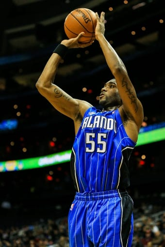 Nov 26, 2013; Atlanta, GA, USA; Orlando Magic point guard E'Twaun Moore (55) shoots a three in the first half against the Atlanta Hawks at Philips Arena. Mandatory Credit: Daniel Shirey-USA TODAY Sports