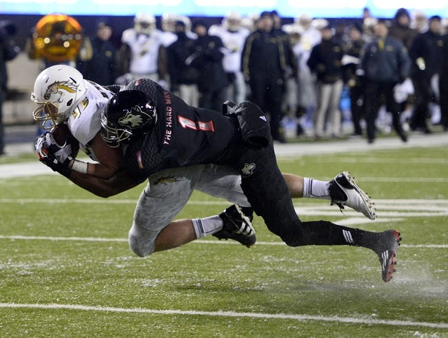 Nov 26, 2013; DeKalb, IL, USA; Western Michigan Broncos linebacker Lucas Cherocci (46) makes a catch against Northern Illinois Huskies safety Dechane Durante (1) during the second quarter at Huskie Stadium. Mandatory Credit: Mike DiNovo-USA TODAY Sports