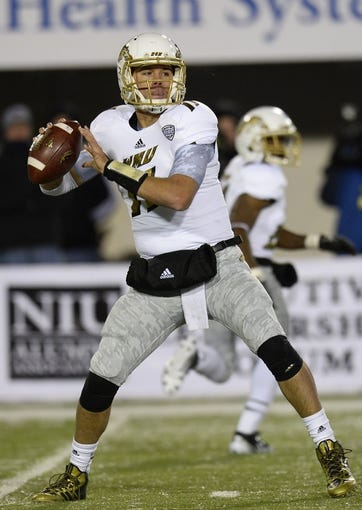 Nov 26, 2013; DeKalb, IL, USA; Western Michigan Broncos quarterback Zach Terrell (11) drops back to pass against the Northern Illinois Huskies during the second quarter at Huskie Stadium. Mandatory Credit: Mike DiNovo-USA TODAY Sports