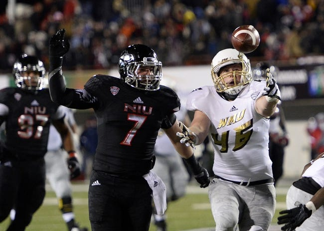 Nov 26, 2013; DeKalb, IL, USA; Western Michigan Broncos linebacker Lucas Cherocci (46) attempts to make a catch against Northern Illinois Huskies linebacker Michael Santacaterina (7) during the second quarter at Huskie Stadium. Mandatory Credit: Mike DiNovo-USA TODAY Sports