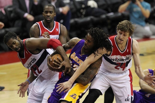 Nov 26, 2013; Washington, DC, USA; Washington Wizards power forward Nene Hilario (42) battles for the ball with Los Angeles Lakers center Jordan Hill (27) and Wizards power forward Jan Vesely (24) in the second  quarter at Verizon Center. The Wizards won 116-111. Mandatory Credit: Geoff Burke-USA TODAY Sports