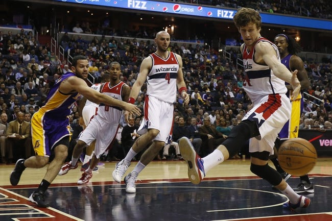 Nov 26, 2013; Washington, DC, USA; Los Angeles Lakers point guard Jordan Farmar (1) passes the ball around Washington Wizards power forward Jan Vesely (24) in the third quarter at Verizon Center. The Wizards won 116-111. Mandatory Credit: Geoff Burke-USA TODAY Sports